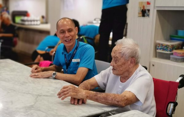 A Heart for Service: Francis chatting with elder at Nee Soon Central Centre