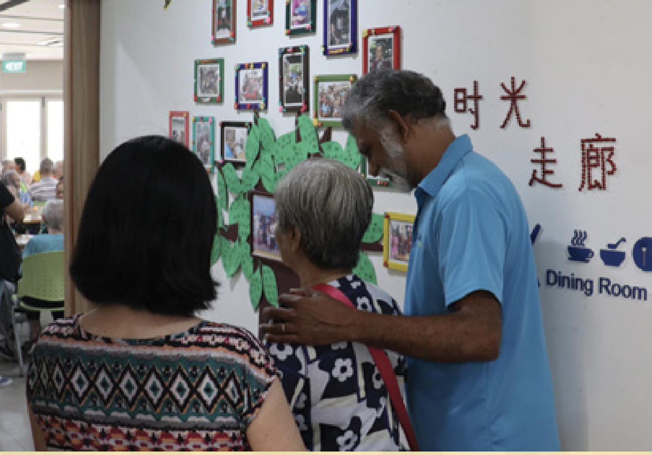 To Give is To receive - Volunteer Sia Lay Meng helping an elder