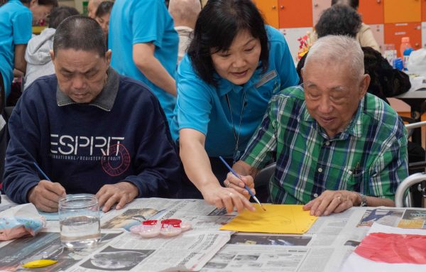 International Friendship Day - Mr Yeo and Mr Aw doing art together